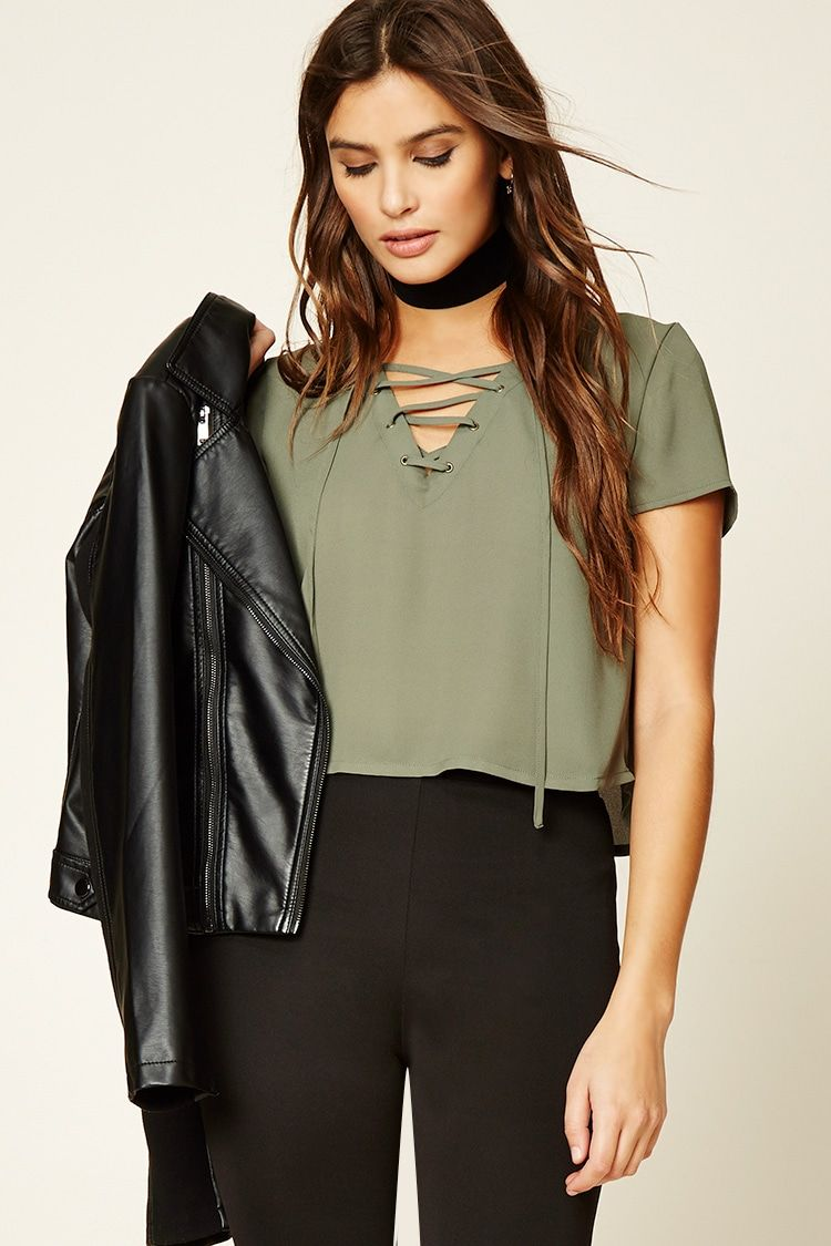 e5e6bd4771f9 A woven top featuring a lace-up front with grommets