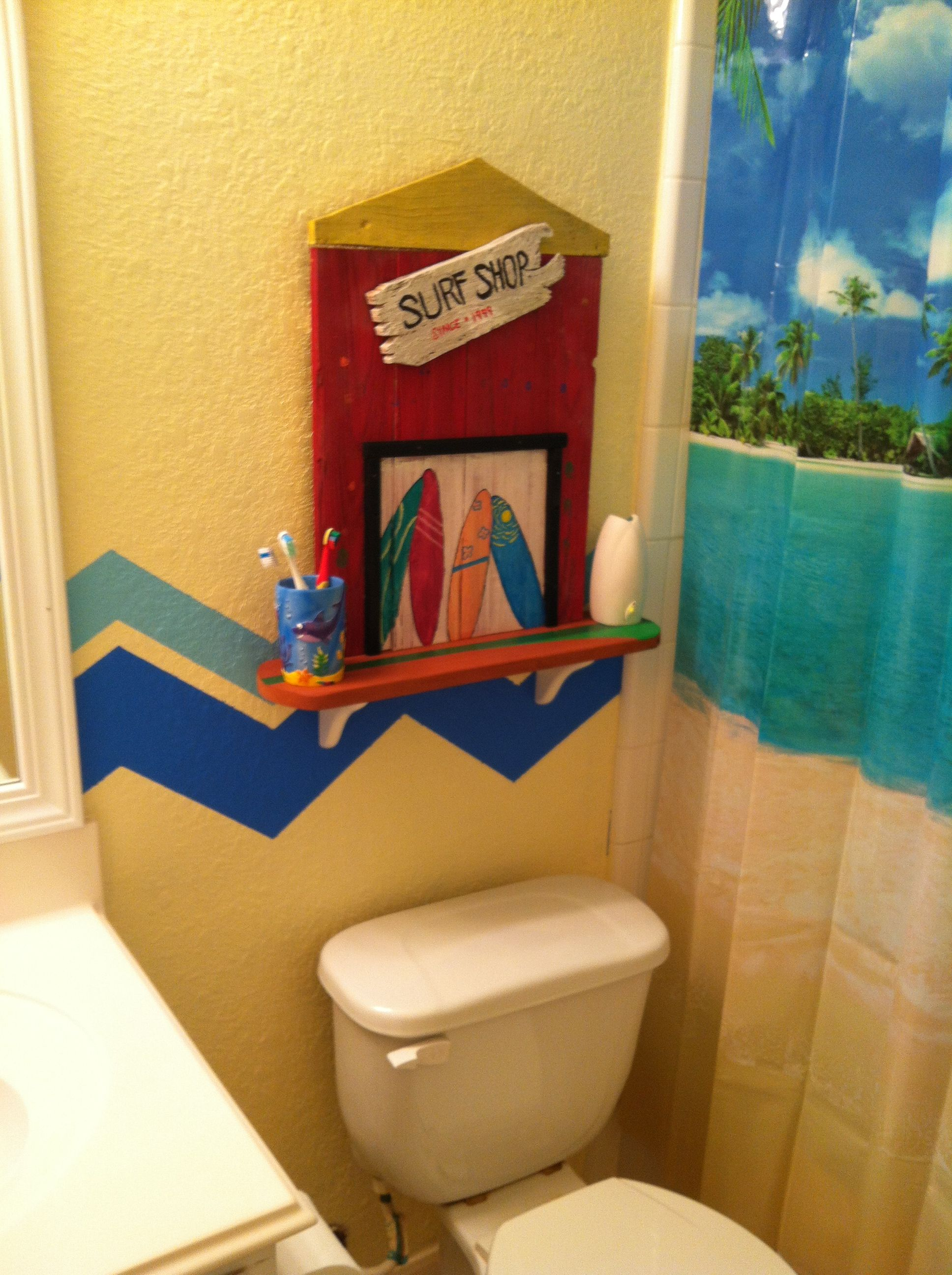 surf shop shelf for the surf themed bathroom made from leftover wood and painted by mom and the