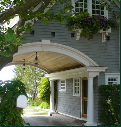 Arched carport.. dreamy!! With lanterns and columns!