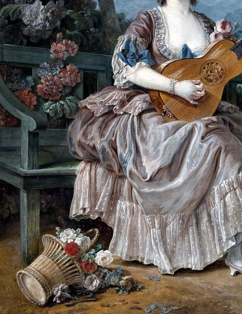 , A lady playing guitar and a child playing with a...