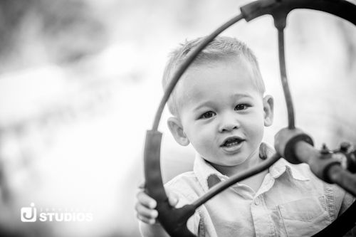 Black and white toddler on a tractor.