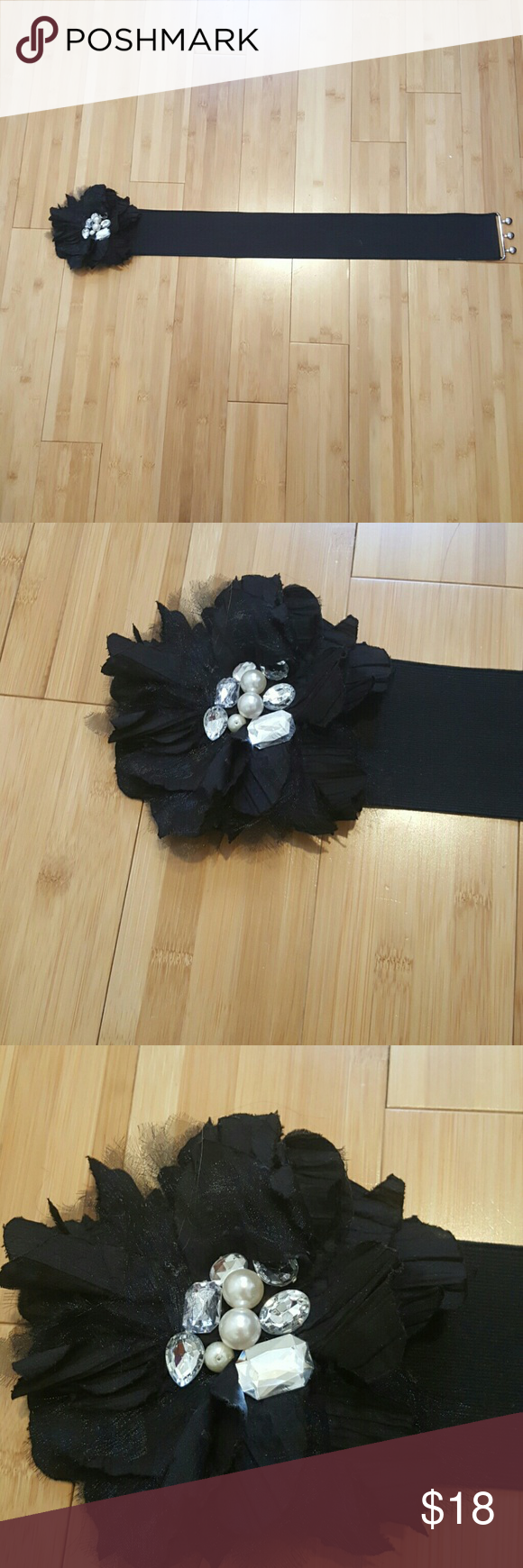 Flower Belt Gorgeous black flower belt by Bebe. Flower has gorgeous faux pearl and rhinestone detail in the center. Fits at the waist. Looks beautiful with a dress. This belt will dress up a simple dress or skirt and blouse. bebe Accessories Belts