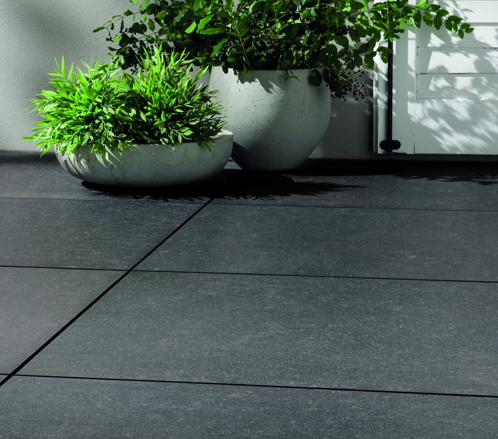 Beautiful black porcelain tiles belgian limestone pinterest these beautiful black paving slabs will look supremely stylish in any setting the midnight tiles are available in two sizes for indoor and outdoor use dailygadgetfo Images