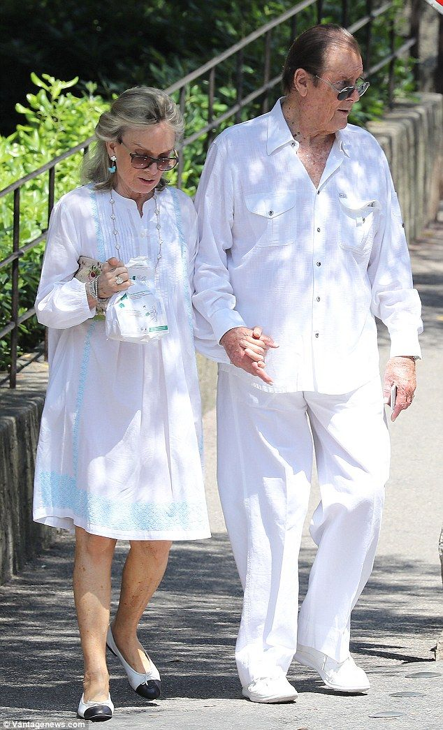 Loved- up: The former Bond star and his wife of fourteen years looked chic in matching whi...