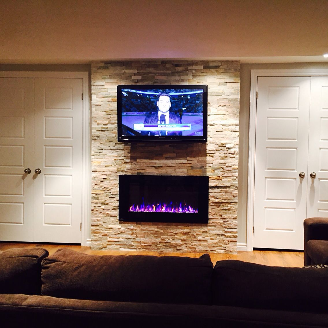 "42"" TV and Napoleon Electric Fireplace with beachwood natural slate wall tile and side by side closet storage"