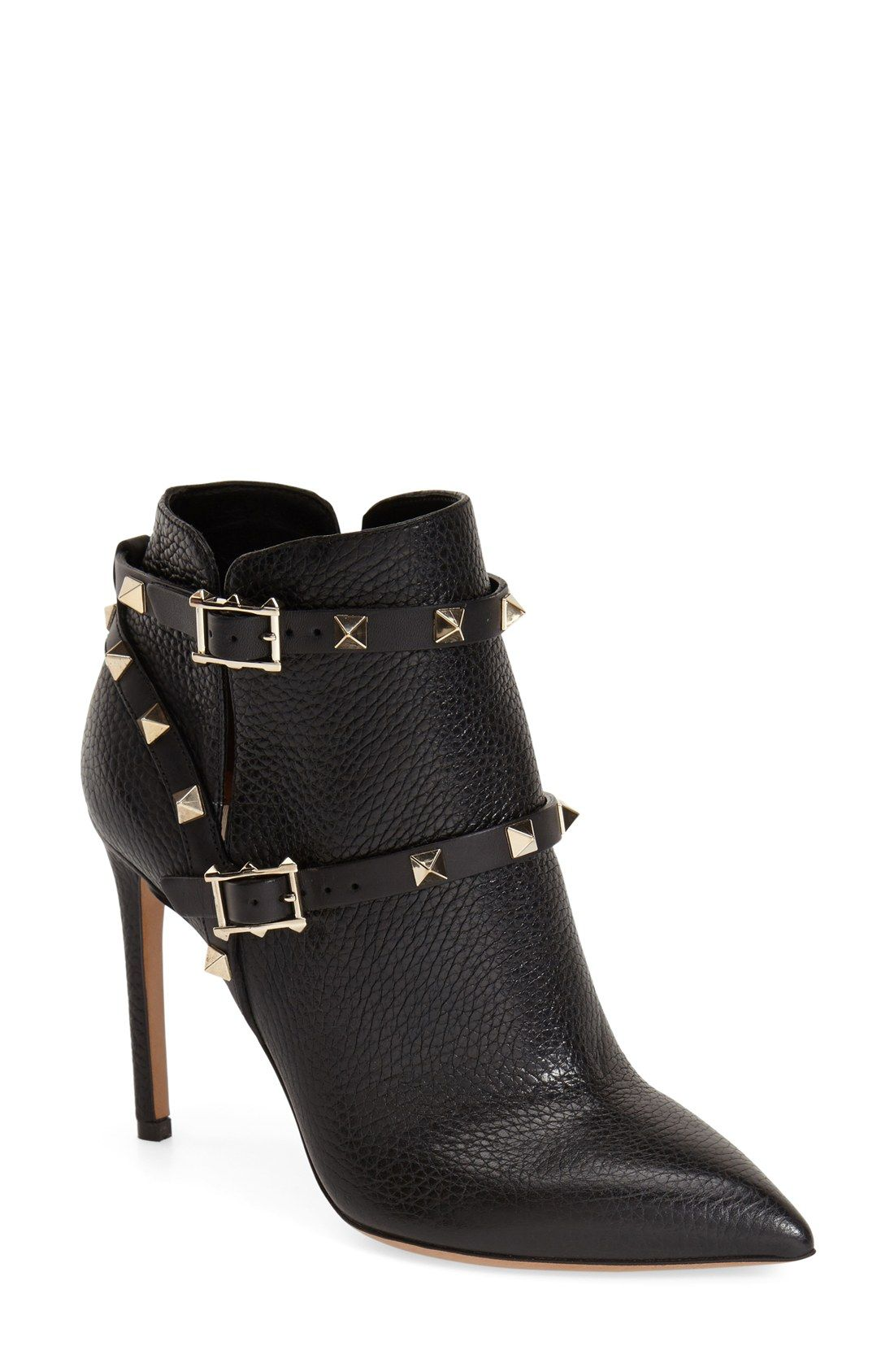 b05d73eb57ce Living for these edgy Valentino  Rockstud  pointy toe booties ...