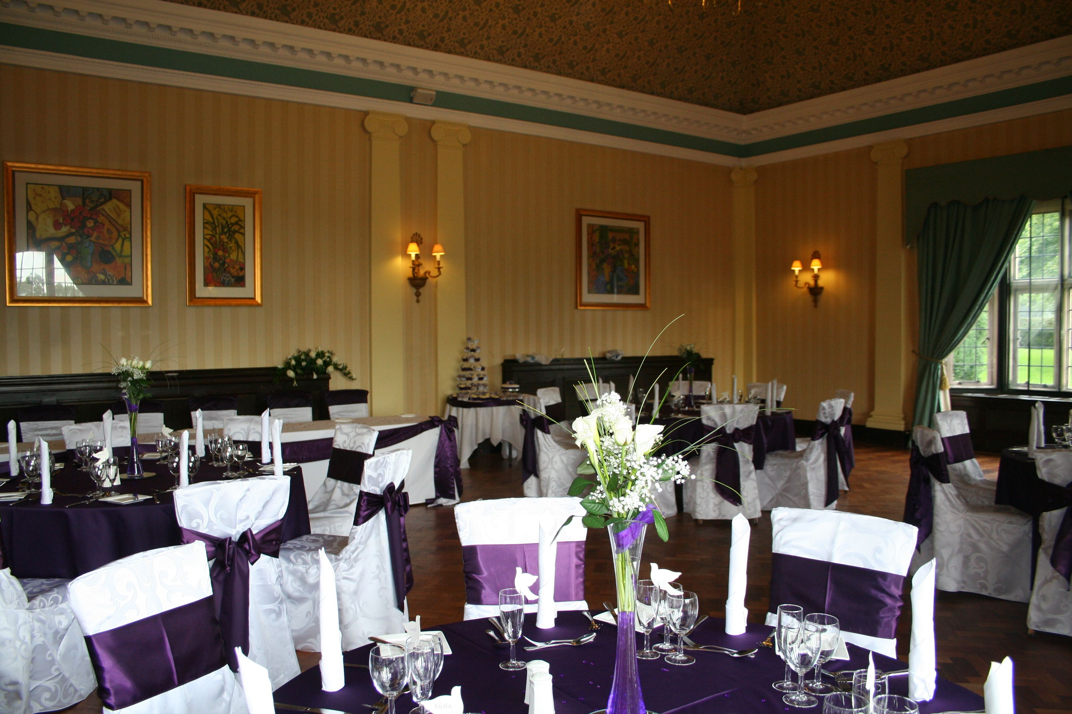chair cover rental charlotte nc lounge walmart dark purple table linen with white damask covers and
