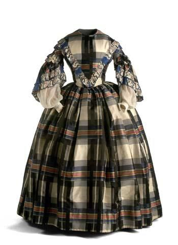 Very interesting plaid dress, but this has one of those useless links. Google image url search led me to a blog in Spanish that included this picture, along with others, which it said were objects at the Museo del Traje in Spain. The links to the museum site didn't work properly and I wasn't able to find this on the website. Sigh. Hate not being able to find the source.