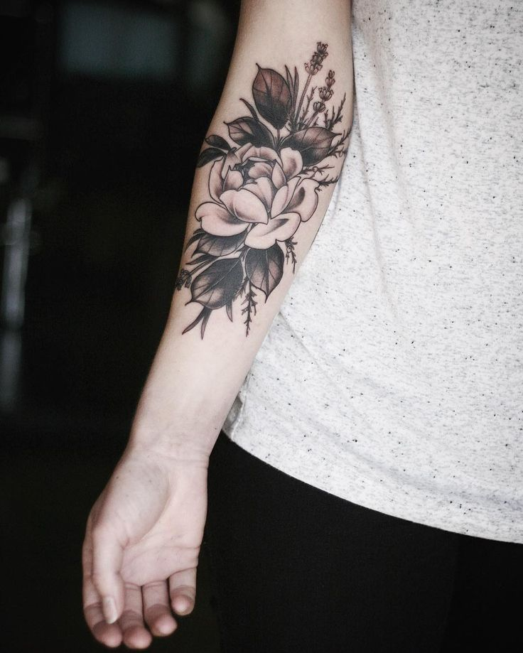 Flower inner arm tattoos