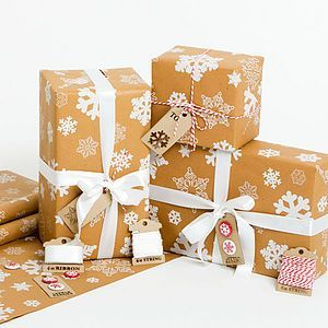 Snowflakes Brown Christmas Wrapping Paper Set. Find delightful Christmas wrapping ideas now.