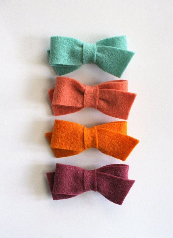Our adorable wool felt sailor bow comes in a variety of colors. This is made to order and can be put