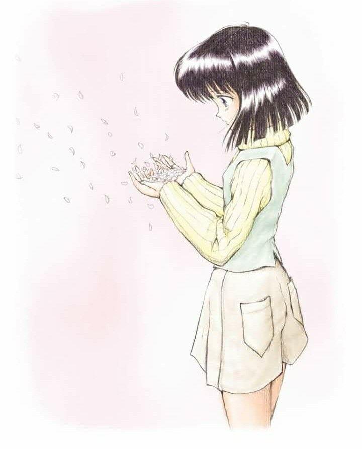 Photo of Hotaru with flower petals in her hands