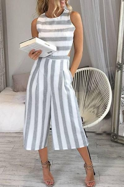 317ca7258bbc Chill out in this sweet sleeveless cropped wide leg culottes style gray and  white striped jumpsuit romper.