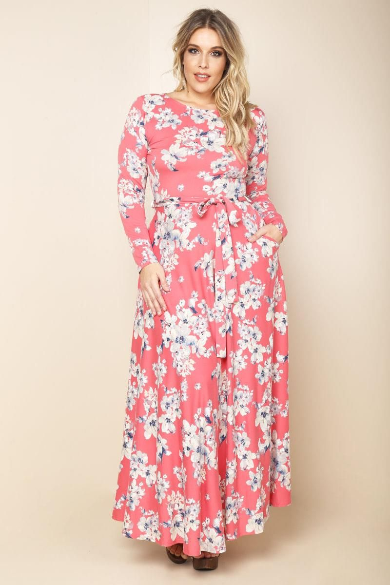 A plus size maxi dress with a boat neckline and long sleeves