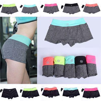 8ab1fc44c2 Aliexpress.com  Comprar Nueva llegada deporte profesional de la aptitud pantalones  cortos mujeres de secado rápido Corto Pantalon Yoga Mujer de Yoga correr ...