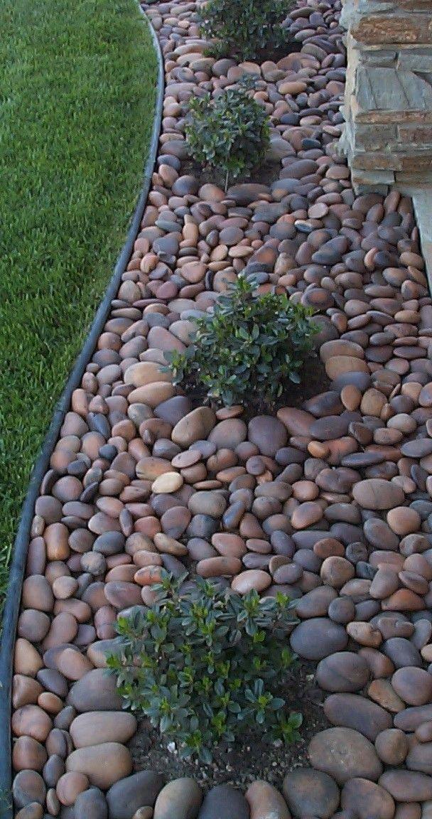 Stone beds around front window and areas | dark garden ...