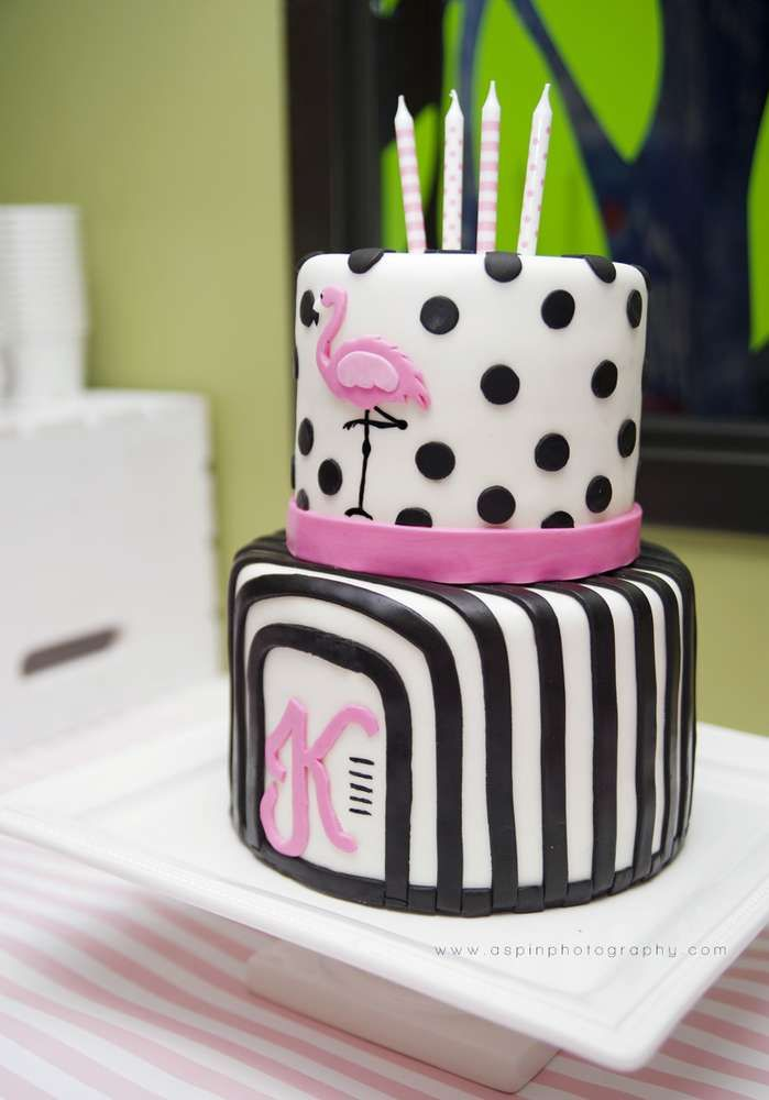 Black and pink cake at a flamingo birthday party! See more party planning ideas at CatchMyParty.com!