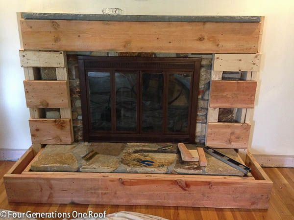 our fireplace makeover stage 3 covering the stone with wood - How To Build A Fireplace Surround