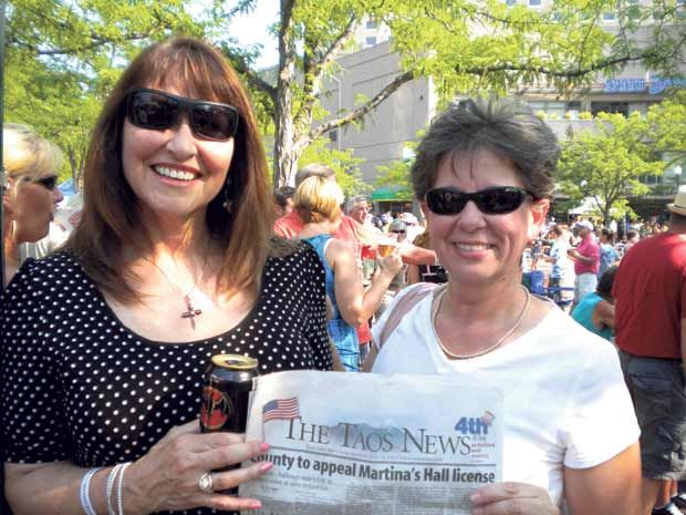 """Now Being Read in Idaho!    Berlene Mace and Kathie Serna enjoy The Taos News in downtown Boise Idaho at """"Alive after five""""."""
