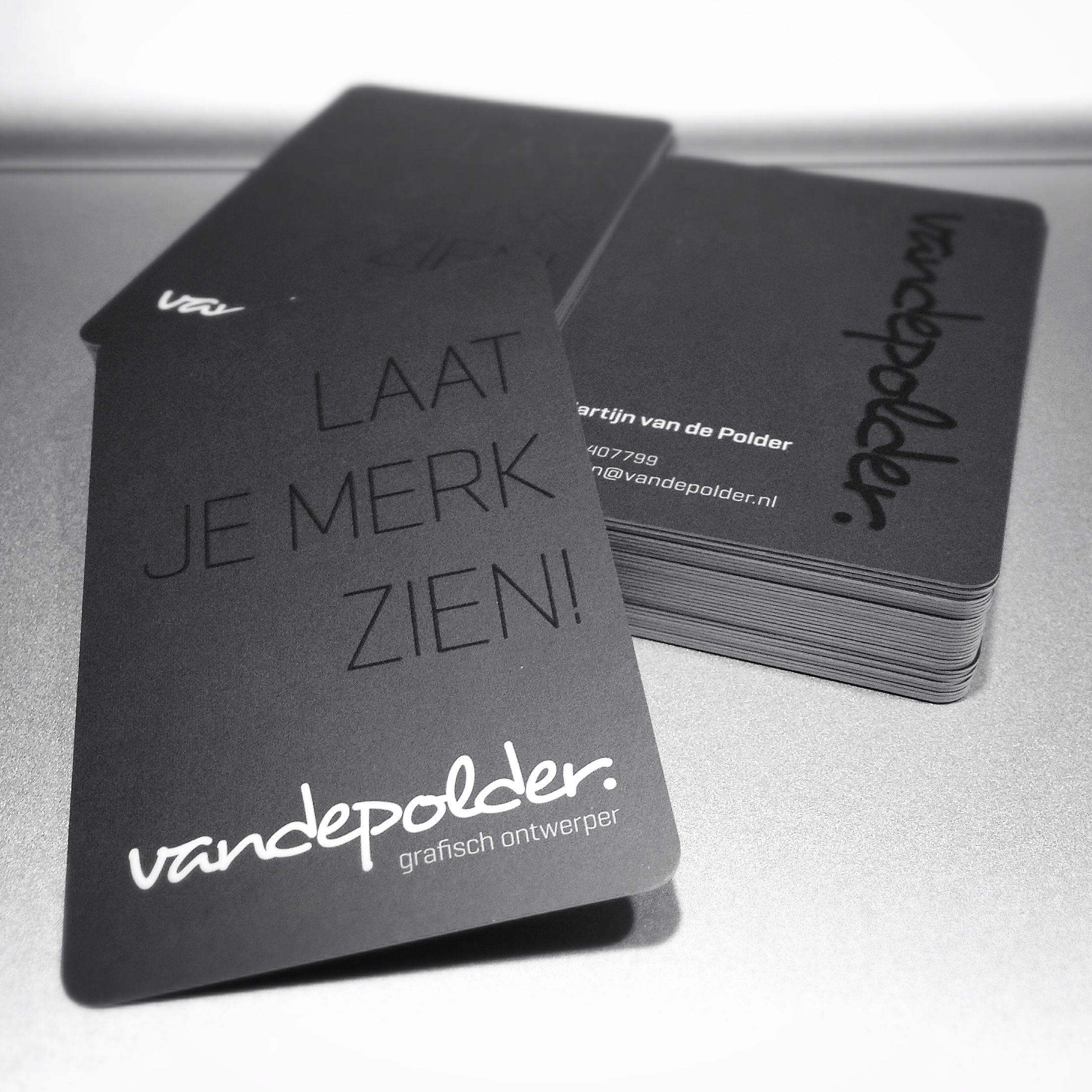 Matte black business card with rounded corners and spot finish on ...