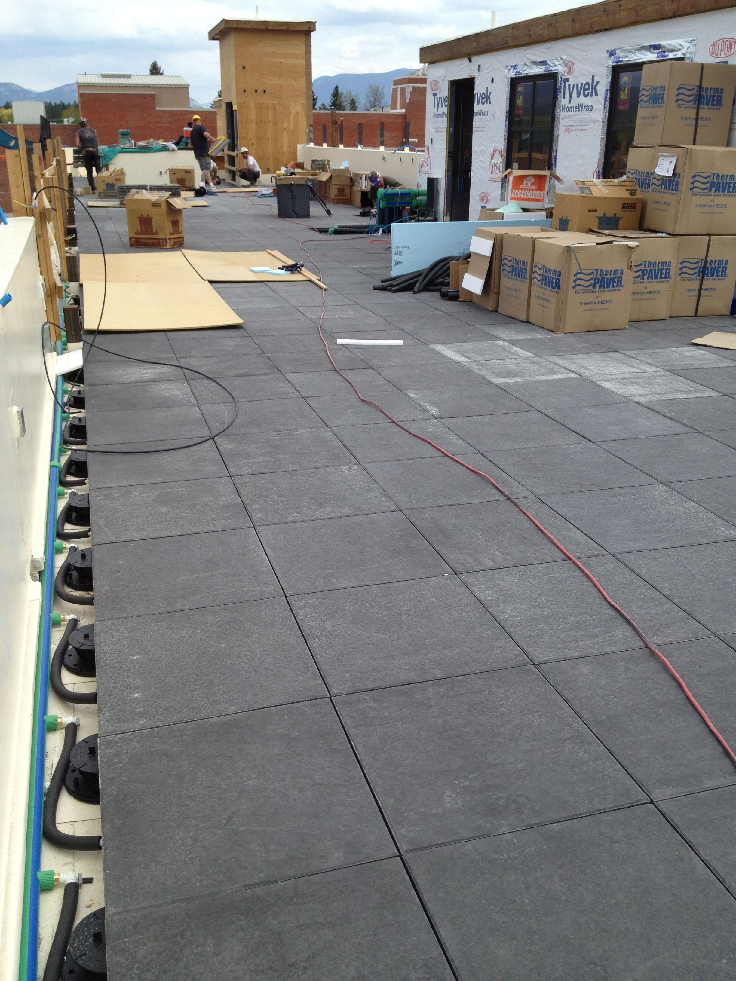 Roof top patio with ThermaPAVER snow melt system installed