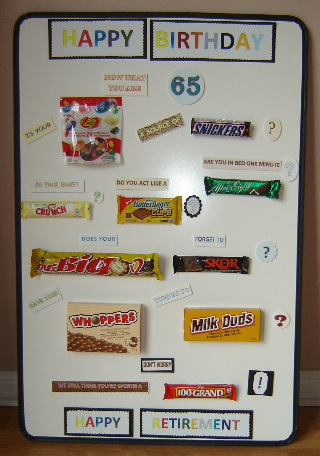 Happy 65th Birthday Poster Said With Chocolate Bars