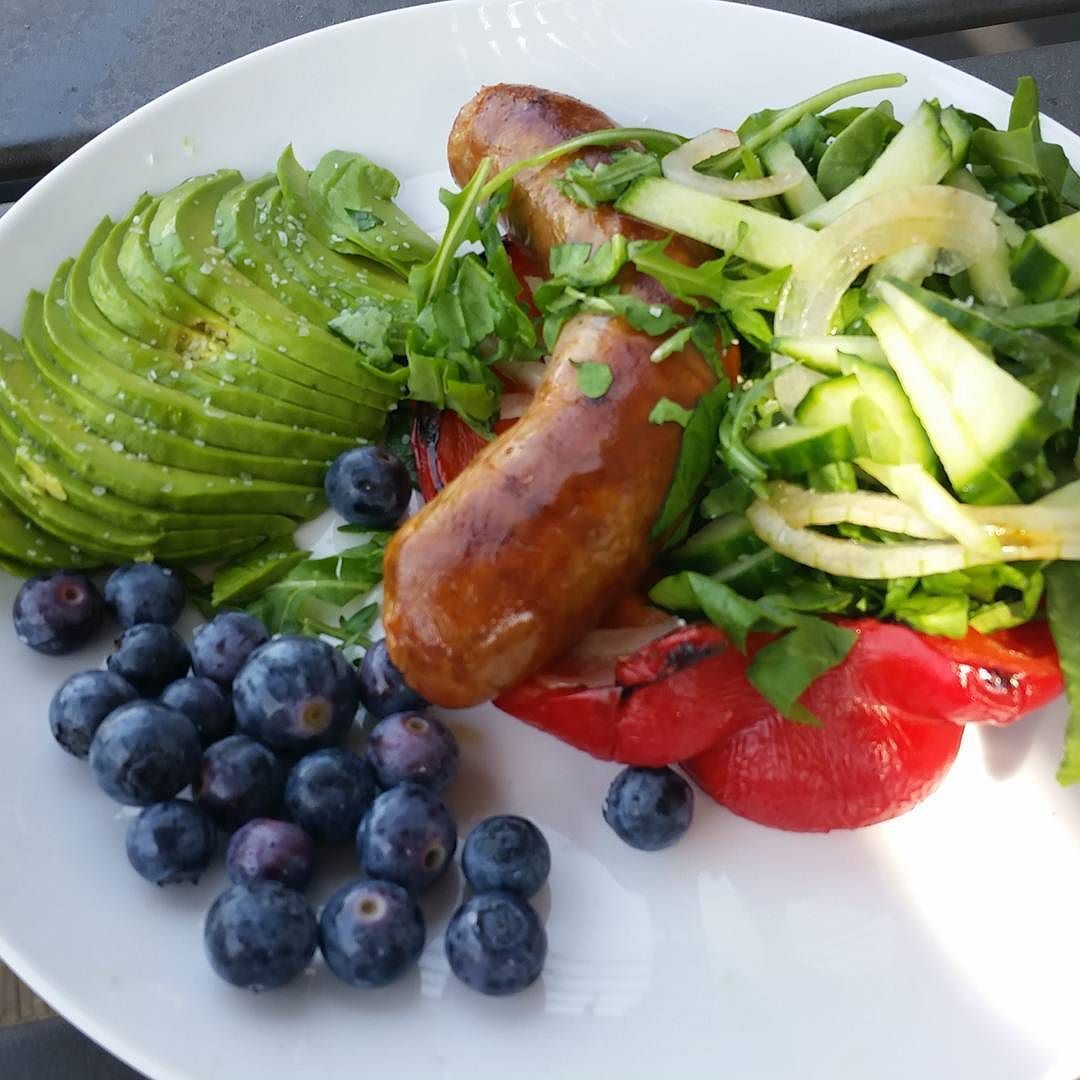 This is freakin' delicious. Flavor party fo' sho!  Bratwurst in a red pepper bun nestled up with chopped greens cucumber strips and shaved onions. Blueberries & avocado.  Threw the sausage & red pepper in the oven together because #simplecooking Chopped the rest the last few minutes it cooked. This entire plate took 10 minutes to prep. It doesn't have to be complicated folks!  #moreveggiesthanavegetarian #wahlsprotocol #paleo mostly #lowhistamine & #bulletproofdiet  #eattherainbow #positivitywins #autoimmune #healthyself #eds #mcad #mastcell by nsonfam
