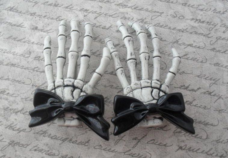 skeleton hand hair clips with black bow accents, pair.