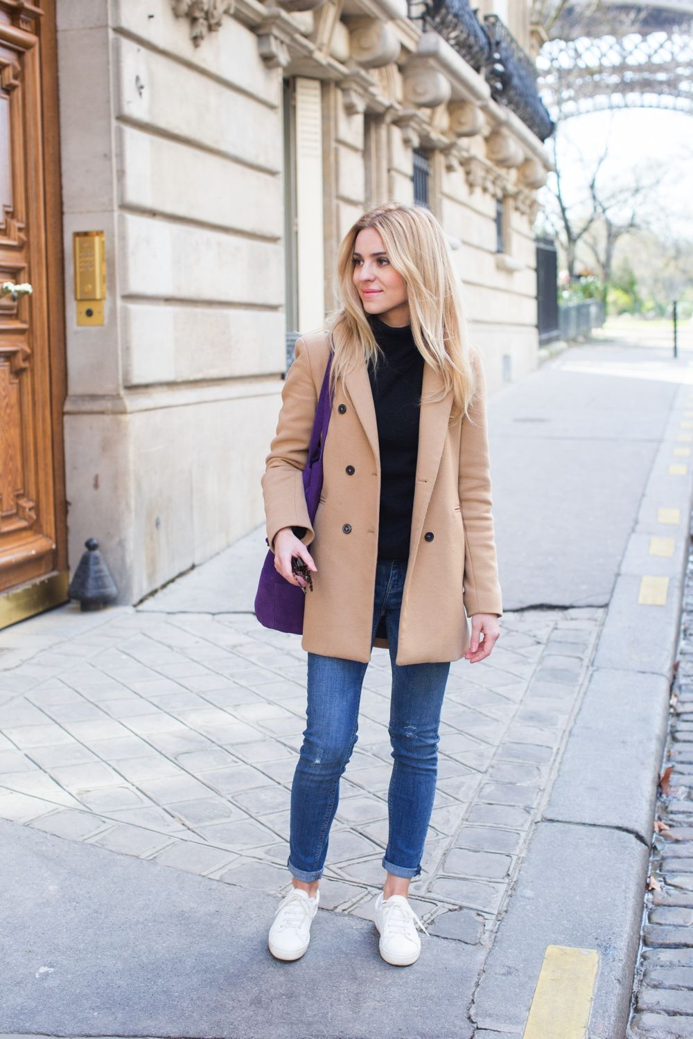 Casual winter outfit: black sweater, camel coat, jeans, white sneakers and  purple
