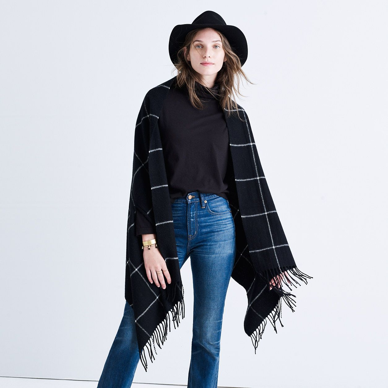 """A superwarm, goes-with-everything scarf in a minimalist grid design. Choose from two classic color combos—this is one you'll reach for over and over. <ul><li>Wool.</li><li>78 3/4""""L x 27 1/2""""W.</li><li>Dry clean.</li><li>Import.</li></ul>"""