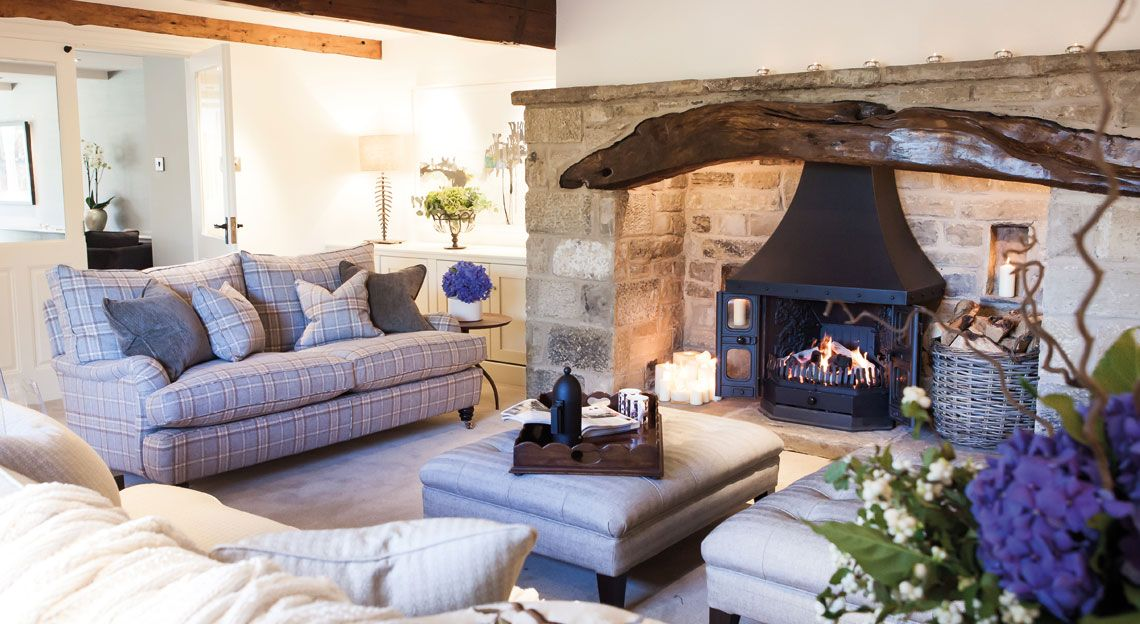 Tartan sofa adds a lovely touch of colour to this relaxing farmhouse living room.