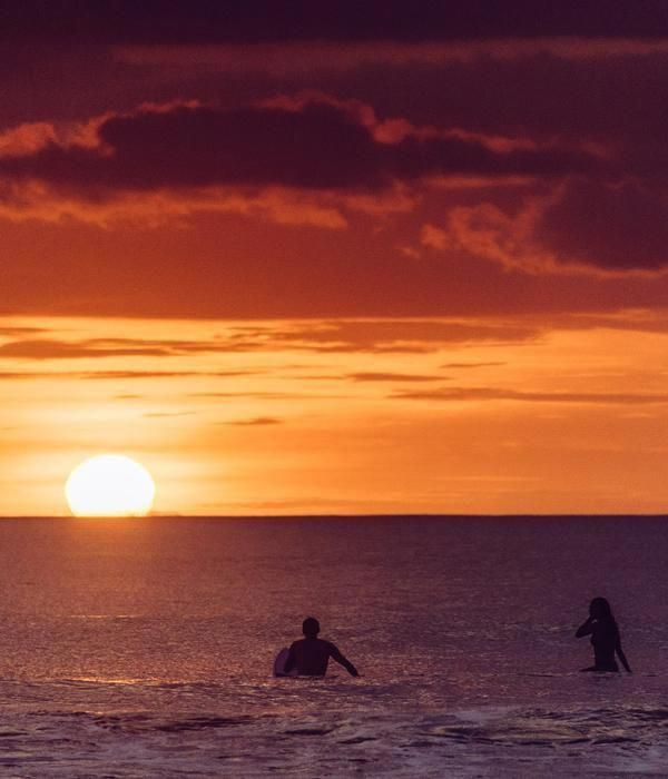 Surf Amor. Surfer couple watching sunset on their surfboards in Tamarindo Costa Rica. Photographed by Kristen M. Brown, Samba to the Sea for The Sunset Shop. sunsets, beach sunset, sunset ocean, sunset photography, sunset surfing, sunset surf, sunset beach surf, sunset beach tropical, sunset Costa Rica, sunset beach waves, sunset beach Summer, sunset beach photography, sunset beach wanderlust #surfer #puravida #sunset #costarica