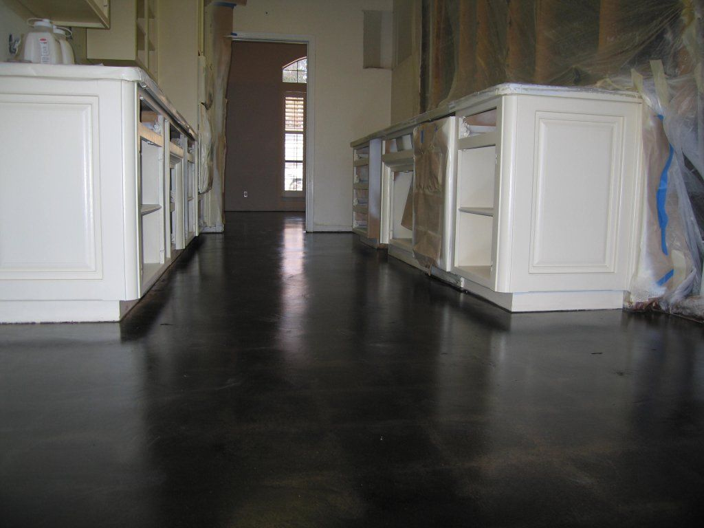 black stained concrete floors. Dark floors  white cabinets brown wall Stained Cement Build a house