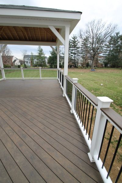 Dig The White Rail With Black Balusters And Wood On Top Railings Exterior Design Kitchen Renovations Curb Appe In 2020 Colorful Patio Backyard Patio Patio Deck Designs