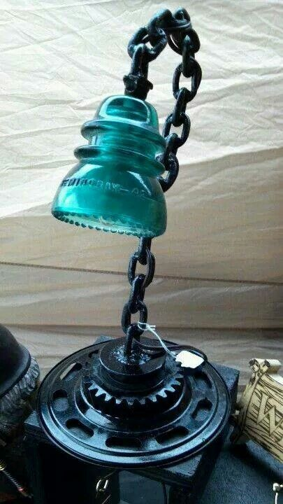 Turquoise & black | reusing, recycling, glass insulator, old chains, gears