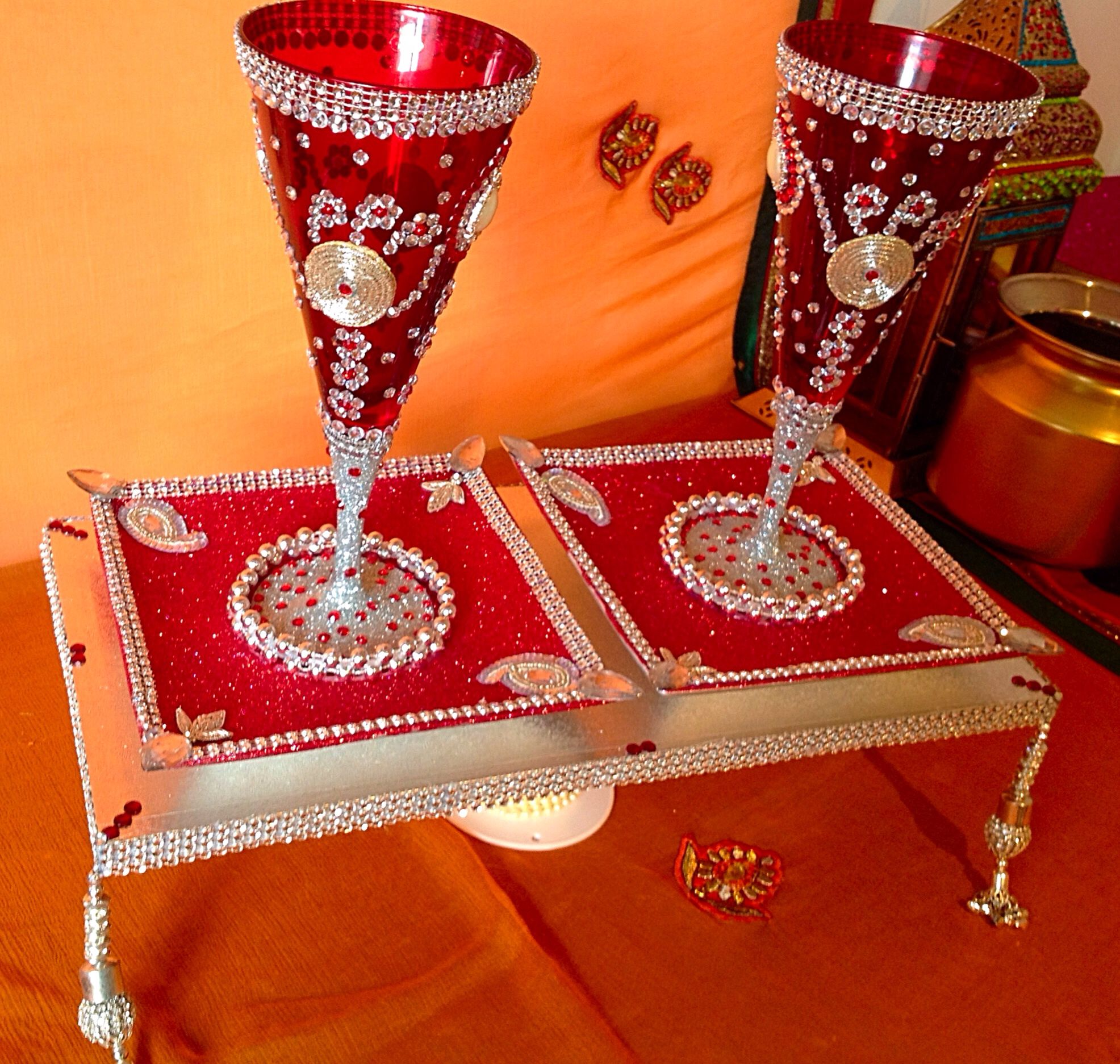 A beautiful set of Doodh Pilai glasses set on matching diamonte plates. See my facbiik page www.facebook.com/mehnditraysforfun for more ideas and inspiration.