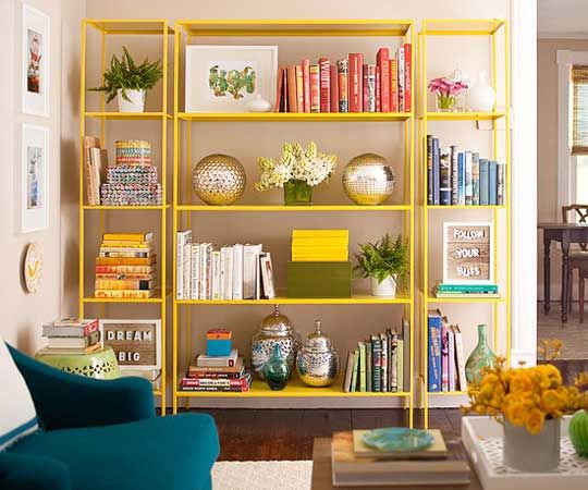 In a post for Better Homes and Gardens, Nicole Balch of the blog Making it Lovely explains how to achieve this look with a set of IKEA Vittsjö shelves and a coat of yellow paint.  Keeping the lines simple and the look sleek allows a bold color to enhance a room without overpowering it. If you tire of yellow (or whatever color you chose), simply spray over for another look.