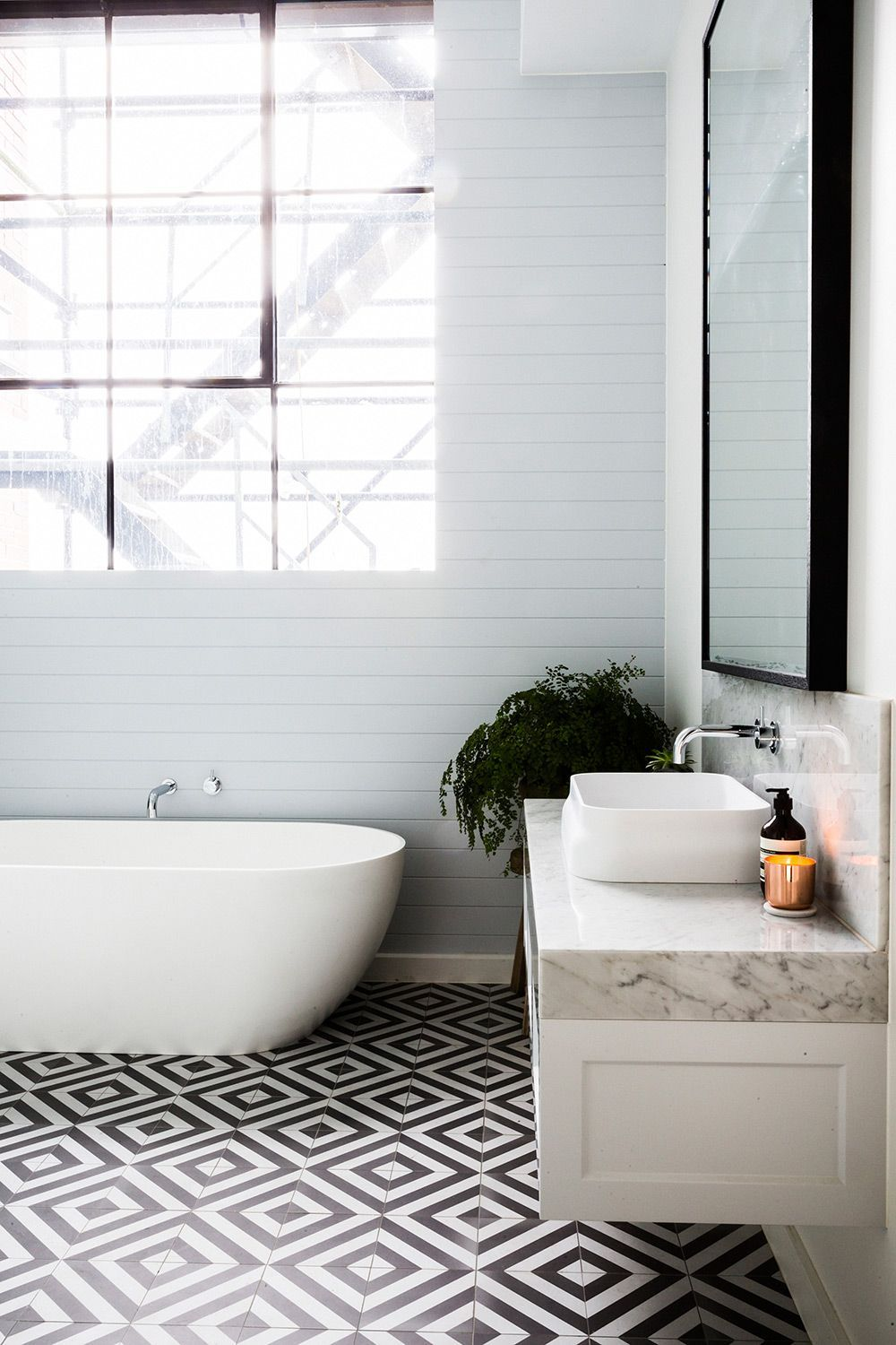 Amazing graphic floor tiles in this bathroom, with a beautiful ...