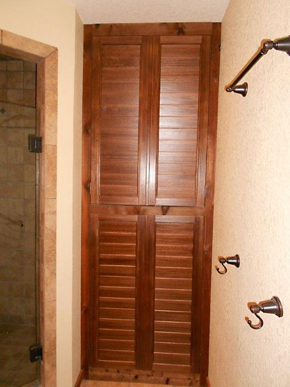 Custom Planation Shutters With Fixed Louvers Made Into Bathroom Cabinet Doors Window Styles Shutter Doors Windows And Doors