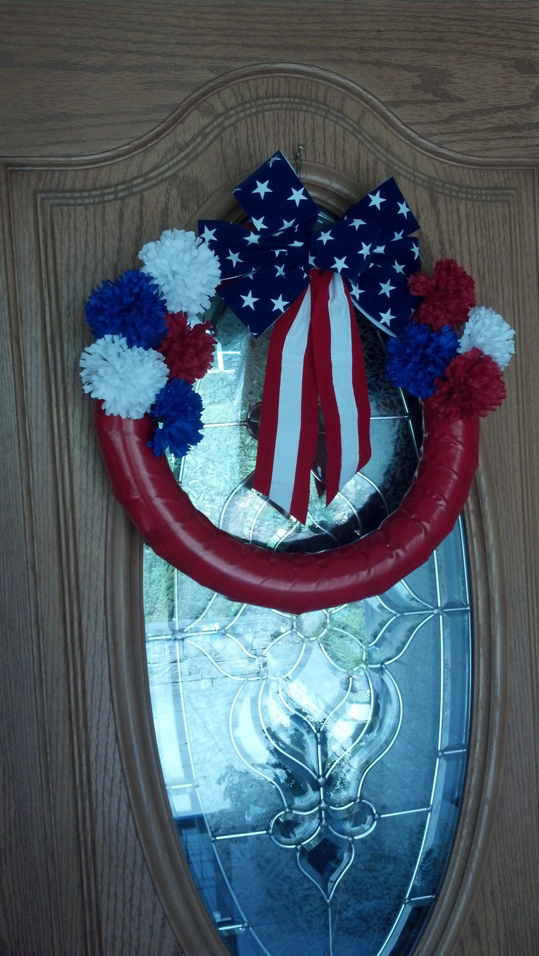 Red, white & blue wreath made from a Dollar Tree pool noodle wreath.  Entire project cost less than $5 (Michaels for the flowers and bow) and took less than 30 minutes to complete. #poolnoodlewreath Red, white & blue wreath made from a Dollar Tree pool noodle wreath.  Entire project cost less than $5 (Michaels for the flowers and bow) and took less than 30 minutes to complete. #poolnoodlewreath