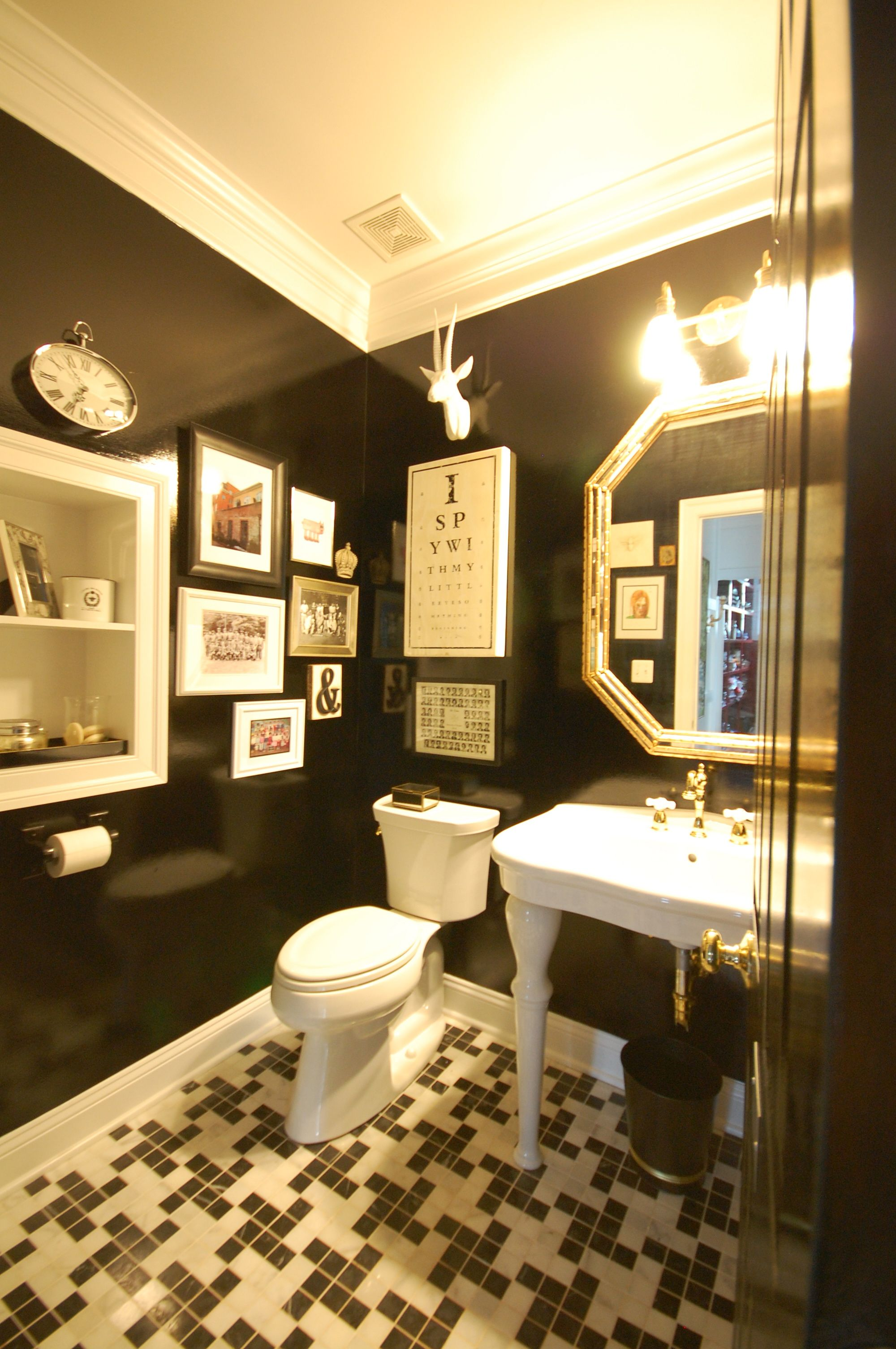 black bathroom | gallery wall; houndstooth tile pattern; pedestal ...