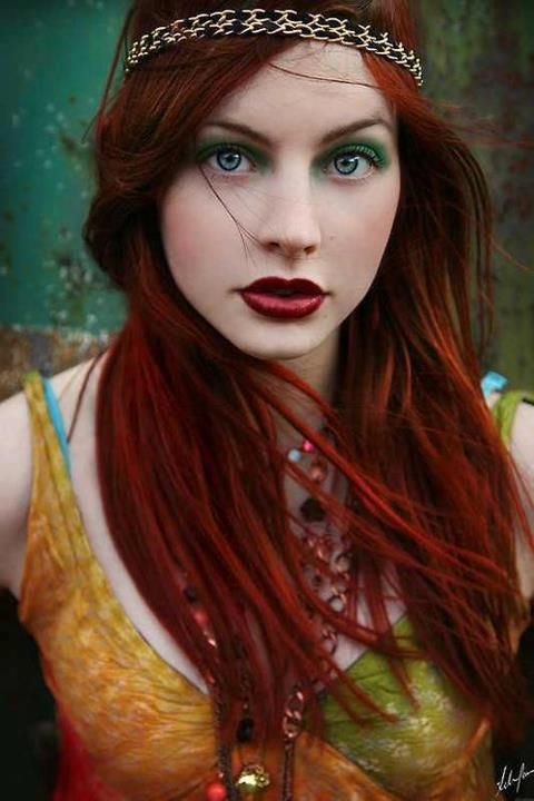Rich red, pale skin, make it a real beauty shocker. Add red to your lips and green to your eyes. Fabulous.