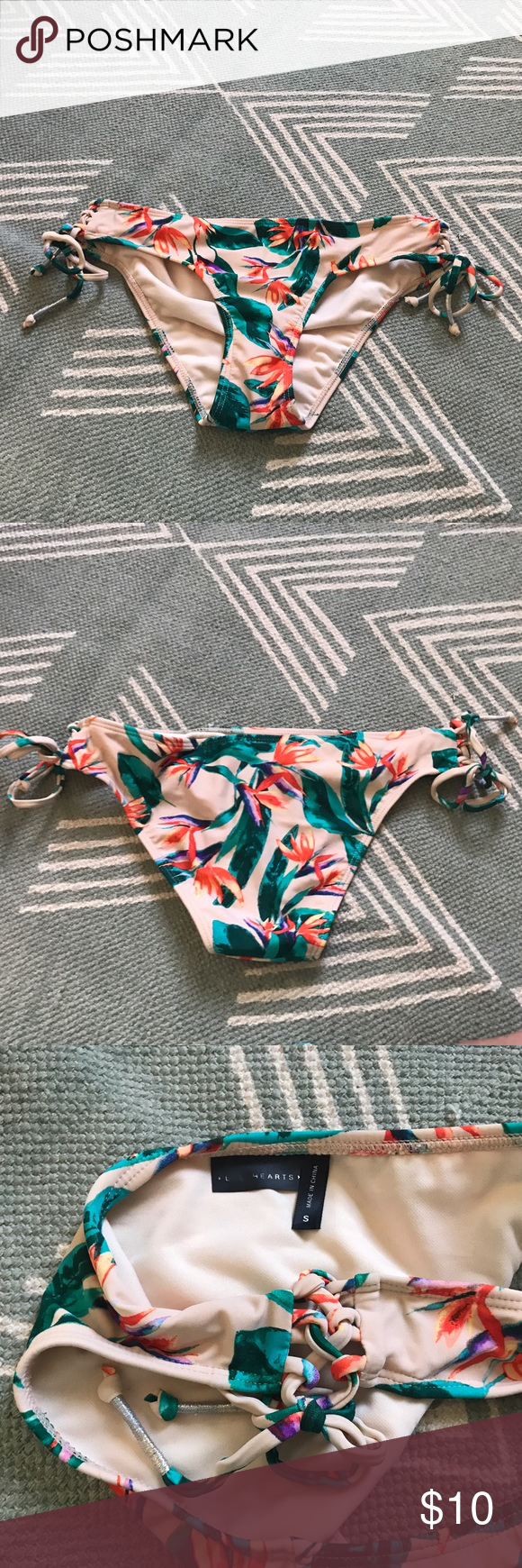Tropical side tie bikini bottoms small NEVER WORN Purchase from Tilly's and never worn. Tilly's Swim Bikinis