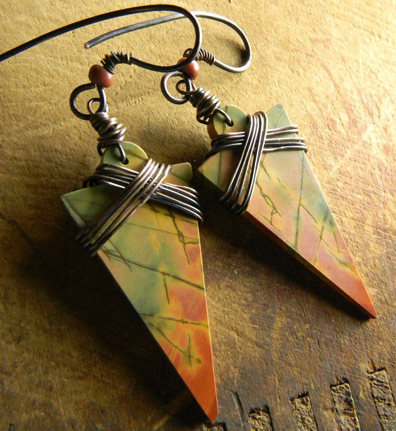 Brilliantly colored red creek jasper arrowhead shaped stones in a mirrored pattern are the body of my bold new earrings design. I have wrapped