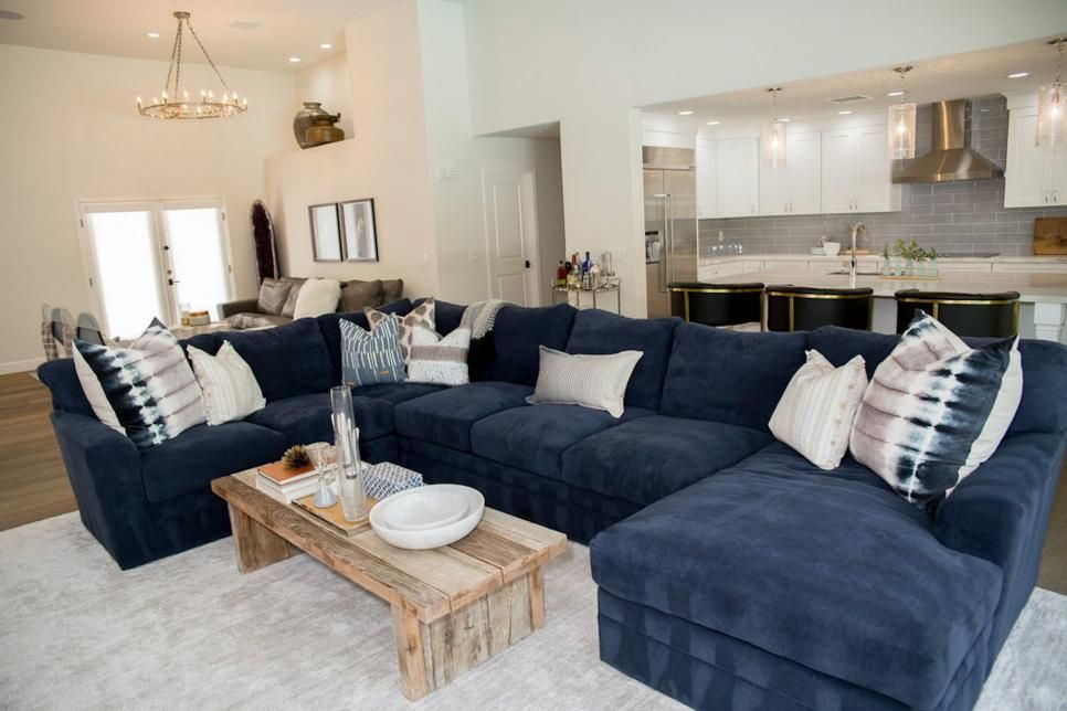 In The Living Room The Blue Suede Sectional Provides The Family With Plenty Of Dura Blue Living Room Decor Blue Sofas Living Room Ashley Furniture Living Room