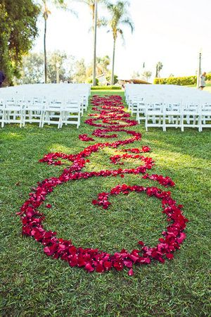 Do something unique with your aisle- create a runner with flower petals and have them arranged in a scroll pattern! (#garden weddings, #pink weddings)