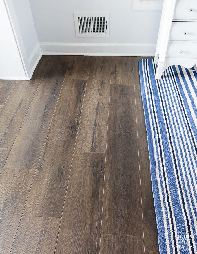 Goodbye Old Carpet, Hello New Laminate Wood Flooring