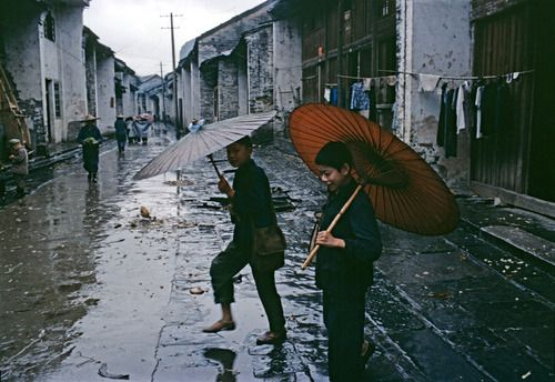 k-a-t-i-e-:  Children running through the rain in a street of Xingping, 1980 Bruno Barbey