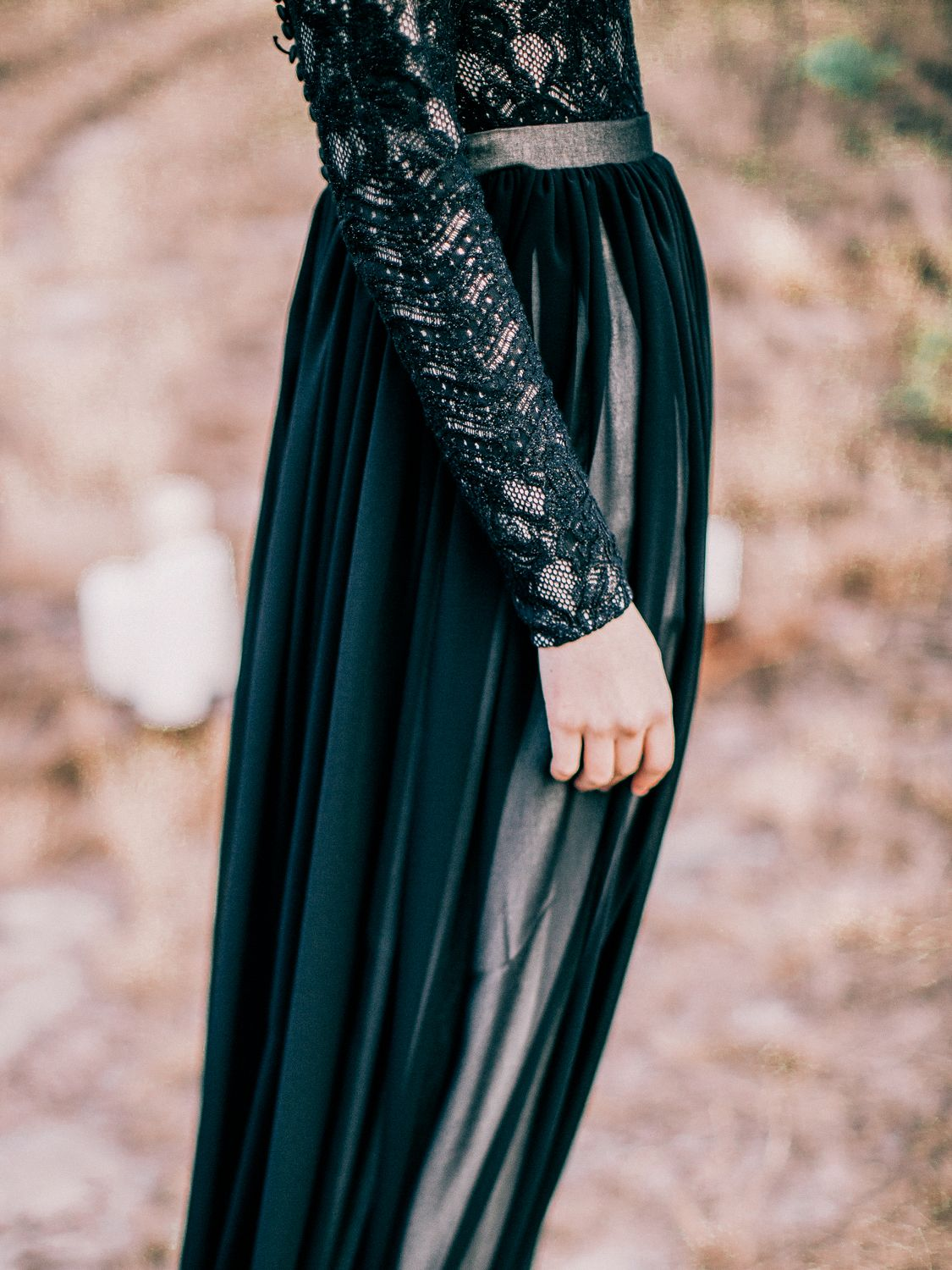 Black highnecked lace wedding dress with long sleeves