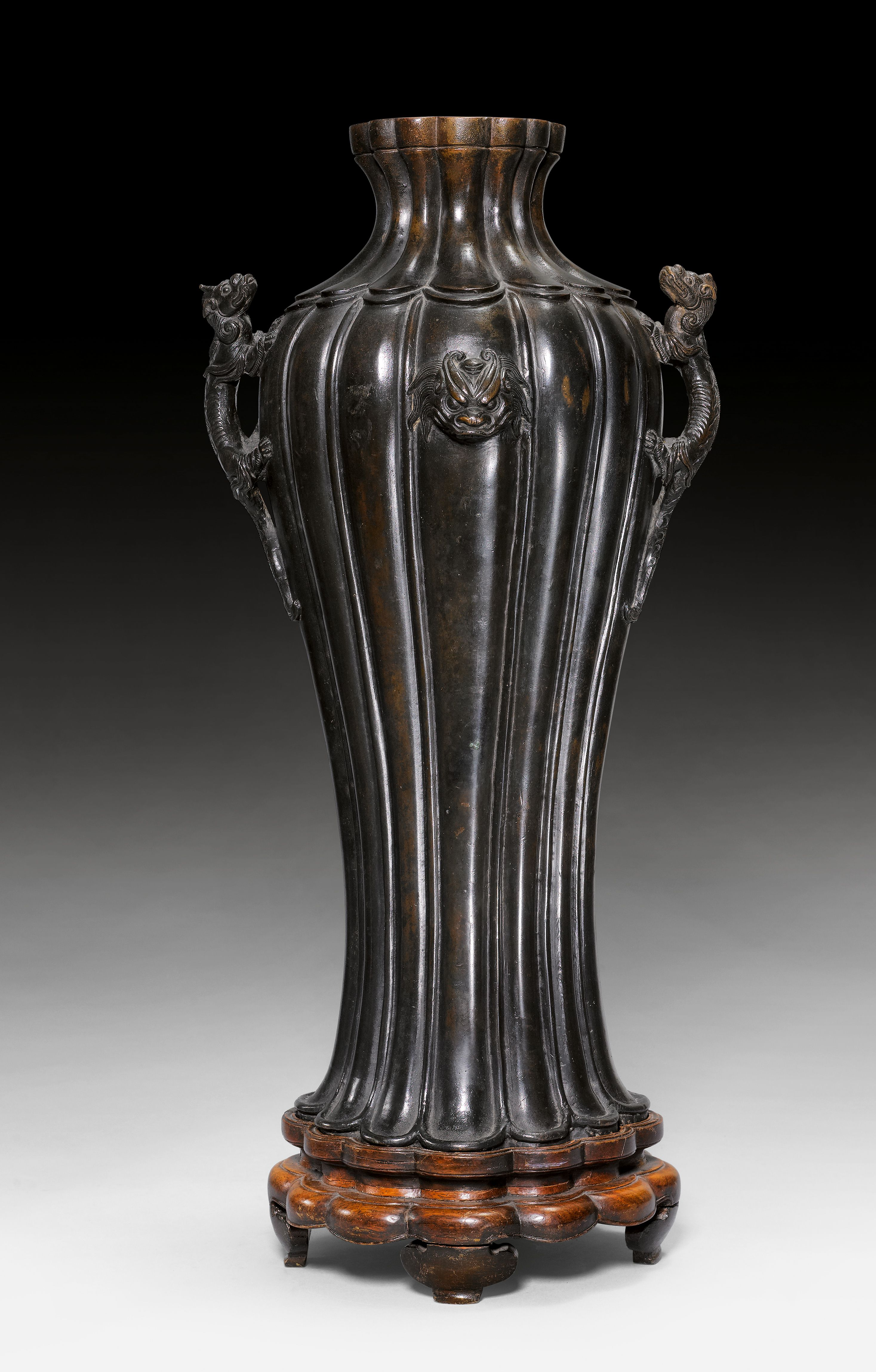 A dark patinated bronze lobed vase with dragon handles and a dark patinated bronze lobed vase with dragon handles and maskarons china ming dynasty reviewsmspy